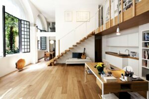 small-home-office-with-white-interior-decoration-ideas-under-wooden-staircase-with-laminate-flooring-tile-parquet-table-kitchen-wall-cabinets-with-door-and-shelving-units